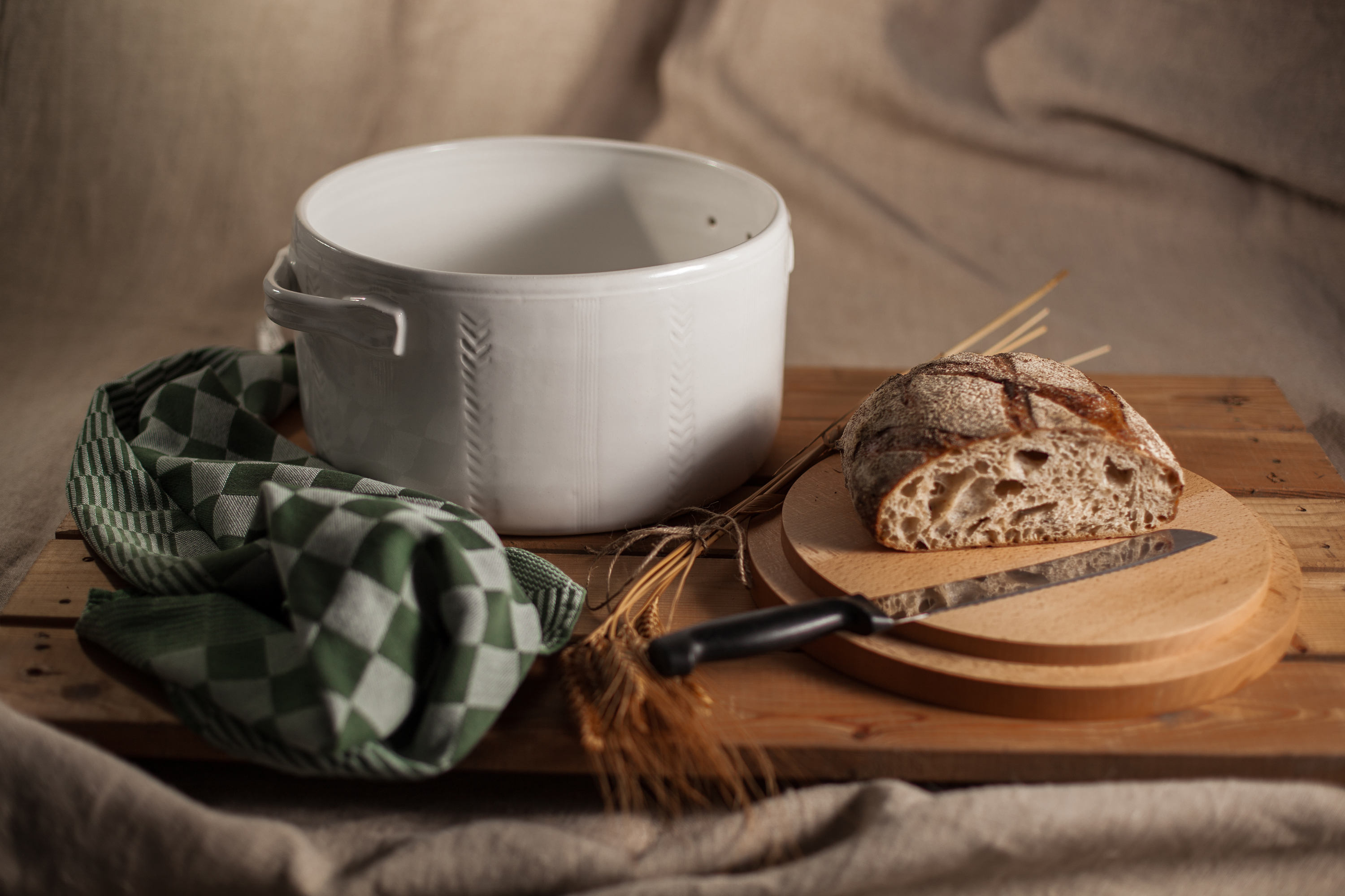 Bread pot,wheel thrown, wooden lid to be used as bread board. Stoneware, surface decoration, white glaze.